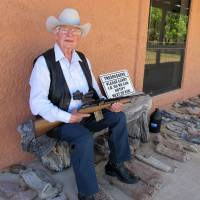 Jim Chilton poses for a photo on the front porch of his home on his 50,000-acre (202-square-kilometer) ranch along the U.S.-Mexico border in Arivaca, Arizona, on March 15. | AP