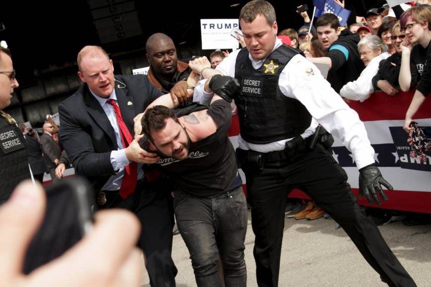 Defiant Trump stares down protesters after rally violence