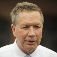 Republican presidential candidate Ohio Gov. John Kasich speaks with members of the media after he voted in the primary election Tuesday in Westerville, Ohio. | AP