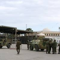 This file photo shows Tunisian soldiers standing guard at the border crossing at Ras Jdir Ben Guerdane on Dec. 5, 2014. | REUTERS