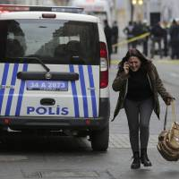 A woman reacts following a suicide bombing in a major shopping and tourist district in central Istanbul on Saturday. | REUTERS