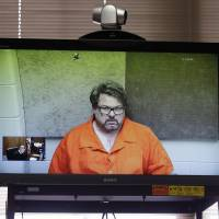Jason Dalton of Kalamazoo Township, Michigan, is arraigned Feb. 22 via video in Kalamazoo. Dalton, charged with killing six people in a series of shootings in southwestern Michigan, had warned his wife the night of the shootings that she wouldn't be able to return to work and their children couldn't go back to school and she'd understand everything by watching TV news. Carole Dalton told investigators she was stumped by what Jason Dalton told her the night of the shootings. | AP