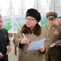 North Korean leader Kim Jong Un speaks at an event declaring the construction of Ryomyong Street in Pyongyang this photo released Friday. | REUTERS