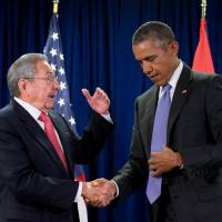 President Barack Obama shakes hands with Cuban President Raul Castro before a bilateral meeting at United Nations headquarters in New York last September. | AP