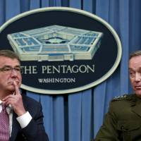U.S. Defense Secretary Ash Carter and Joint Chiefs Chairman Marine Gen. Joseph Dunford hold a joint news conference at the Pentagon in Washington Monday.   REUTERS