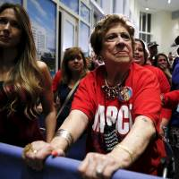 Supporters react as Republican U.S. presidential candidate Sen. Marco Rubio announces the suspension of his campaign during a rally in Miami on Tuesday. | REUTERS