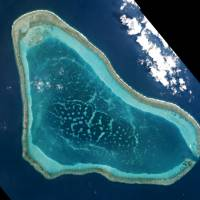 Boats at Scarborough Shoal in the South China Sea are shown in this photo taken on March 12. The head of U.S. naval operations, Adm. John Richardson said the U.S. military had seen Chinese activity around Scarborough Shoal in the northern part of the Spratly archipelago, about 125 miles (200 km) west of the Philippine base of Subic Bay. | REUTERS