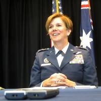 Gen. Lori Robinson, the commander of the Pacific Air Forces, talks to reporters Tuesday at the U.S. Embassy in Canberra. Robinson said the U.S. Air Force will continue to fly daily missions over the South China Sea despite a buildup of Chinese surface-to-air missiles and fighter jets in the contested region. | AP