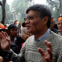 Dissident Nguyen Quang A speaks during an anti-China rally in Hanoi on Feb. 16. | AFP-JIJI
