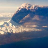 Alaska volcano spews ash cloud 400 miles, causing flight cancellations, raised USGS alert
