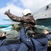 In this photo provided by the Russian Defense Ministry Press Service, a Russian pilot receives a hero's welcome on returning from Syria at an airbase near the Russian city Voronezh, Tuesday. | OLGA BALASHOVA / RUSSIAN DEFENSE MINISTRY PRESS SERVICE VIA AP
