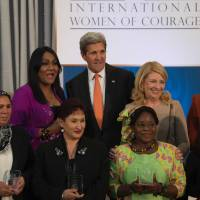 French recipient of the 2016 International Women of Courage Award, Latifa Ibn Ziaten (second, left), poses with U.S. Secretary of State John Kerry and other awardees at the State Department in Washington, D.C., Tuesday. | AFP-JIJI