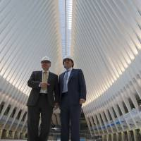 Architect Santiago Calatrava (right) and Steve Plate, director of capital projects for the Port Authority of New York and New Jersey, speak to reporters during a media tour of the World Trade Center Transportation Hub in New York on Feb. 25. | AP