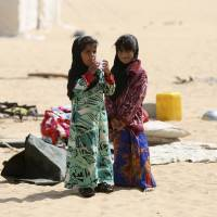 Girls stand at a camp for internally displaced people in Yemen's central province of Marib on Wednesday. | REUTERS