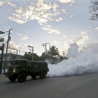 A military truck carries out fumigation in a neighborhood to stop the breeding of the dengue mosquito in Havana Tuesday. Cuba conducts regular fumigation inside homes to check the spread of dengue, a virus transmitted by the Aedes aegypti mosquito that causes a fever that can be deadly. The same mosquito can also spread the Zika virus. | REUTERS