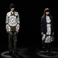 Designer Tsukasa Mikami opened Tokyo fashion week on March 14 with a show featuring male and female models in floral silkscreen-printed garments and combat boots. Mikami, whose previous collections have showcased men and women wearing the same garments, said creating unisex clothing came naturally. | AFP-JIJI
