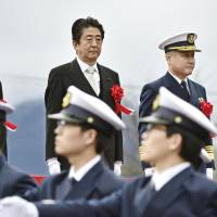 Prime Minister Shinzo Abe attends a graduation ceremony at the Japan Coast Guard School in Maizuru, Kyoto Prefecture, on Saturday. | KYODO