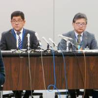 Officials at a child consultation center in Sagamihara, Kanagawa Prefecture, attend a news conference at the municipal office on Tuesday following the death of a 14-year-old boy who died as a result of a 2014 suicide attempt after the center declined to remove him from his parents despite evidence of physical abuse.   KYODO