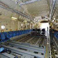 The Air Self-Defense Force shows off the inside of its C-2 next-generation transport aircraft in Kakamigahara, Gifu Prefecture, on Tuesday. | KYODO