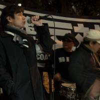 An anti-nuclear activist addresses a rally assembled in front of the Prime Minister's Office on Friday night, on the fifth anniversary of the March 11, which triggered a meltdown at Fukushima No. 1 nuclear power plant.  | DREW BATEMEN