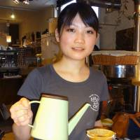 Yuka Takahashi, crowned Japan's best brewer of drip coffee, pours a cup on Feb. 3 in Tokyo. | KYODO