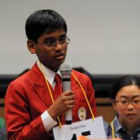 Vishwag Paleri, 12, from the India International School in Japan in Tokyo, spells a word during the 7th Japan Times Bee in Tokyo on Saturday. | SATOKO KAWASAKI