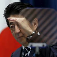 Prime Minister Shinzo Abe speaks during a news conference at his official residence in Tokyo late Tuesday. | REUTERS