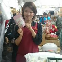Sayaka Watanabe sells camellia tea products at an event. | RE:TERRA CO./KYODO