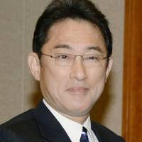 Kishida plans China visit in April for talks with counterpart Wang