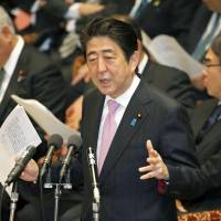 Prime Minister Shinzo Abe speaks during a Lower House Budget Committee session Tuesday. | KYODO