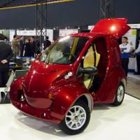 A prototype of an electric vehicle developed for use in cold regions is displayed during the Sapporo Motor Show in January. | KYODO