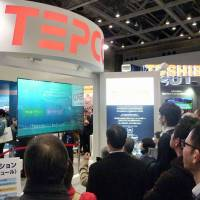Visitors to the Energy Market Liberalization Expo in Tokyo on March 4 hear a presentation by Tokyo Electric Power Co. | KYODO