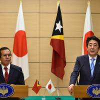 East Timor President Taur Matan Ruak listens as Prime Minister Shinzo Abe speaks during a joint news conference at the prime minister's official residence in Tokyo on Tuesday. | AFP-JIJI