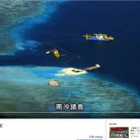A screen shot from a new video posted to the Foreign Ministry's website shows what appears to be land-reclamation projects in the South China Sea.