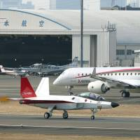 A prototype of the first Japan-made stealth fighter (forefront) is put through ground tests at Nagoya airport Feb. 24. | POOL / KYODO