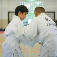 Students attend a judo class in the city of Osaka as part of their extracurricular activities. | ISTOCK