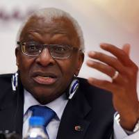 Departing International Association of Athletics Federations (IAAF) President Lamine Diack speaks during an August press conference in Beijing ahead of the 2015 IAAF World Championships. French prosecutors are investigating suspicions of corruption surrounding bidding for this year's Rio Olympics and the 2020 Games in Tokyo, a judicial source told AFP on Tuesday. The inquiry is part of the wider investigation into Diack and his son, Papa Massata Diack.  | AFP-JIJI