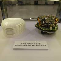 A wireless networking device based on the next-generation WiGig standard is displayed by Panasonic Corp. at Narita airport in late February. | SHUSUKE MURAI