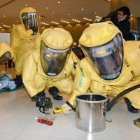 Firefighters in protective suits take part in an anti-chemical terrorism drill Wednesday in the city of Hiroshima, where the Group of Seven foreign ministers' meeting will be held next month. | KYODO