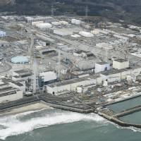 Tokyo Electric Power Co. said Thursday it has started freezing soil around damaged nuclear reactor buildings at the Fukushima No. 1 nuclear power plant. | KYODO