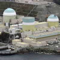 Shikoku Electric Power Co. is considering scrapping reactor 1 (center) of the Ikata nuclear power plant in Ehime Prefecture.