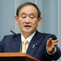 Chief Cabinet Secretary Yoshihide Suga addresses reporters on Wednesday. | KYODO