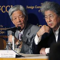 Journalists Soichiro Tahara (left) and Shuntaro Torigoe attend a news conference at the Foreign Correspondents' Club of Japan, in Tokyo on Thursday. | AP