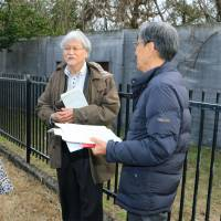 Hideo Inoue (second from right), head of the Supreme Court's panel, inspects a site at a former medical prison used for special courts for leprosy patients in Koshi, Kumamoto Prefecture, on Feb. 29.   KYODO