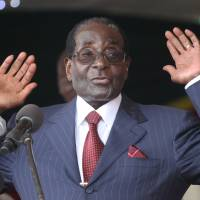 Zimbabwean President Robert Mugabe gestures Feb. 27 as he delivers his speech during celebrations to mark his 92nd birthday celebrations in Masvingo about 300 km south of Harare. 'Do you want me to punch you to the floor to realize I am still there?' The speaker was not a boxer trash-talking before a fight. It was Mugabe, who is 92 and known for pugnacious comments. This one, to an interviewer from state TV, was in response to a question about retirement plans and who would succeed him. 'Why 'successor' when I am still there?' Mugabe said in the interview aired Thursday night. 'Why do you want a successor?'   AP