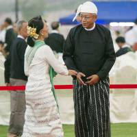 National League for Democracy leader Aung San Suu Kyi (left) is welcomed by new Myanmar President Htin Kyaw during a dinner reception in Naypyitaw on Wednesday. | AP