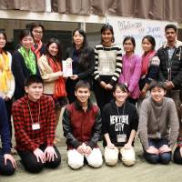 Nepalese and Japanese youths pose for a photo during a program in December in Miyagi Prefecture, in which they shared experiences. | COURTESY OF JAPAN ISRAAID SUPPORT PROGRAM / KYODO