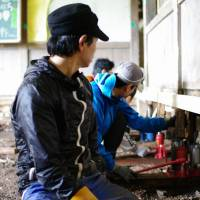 Takashi Tachibana and a team of volunteers renovate a 93-year-old abandoned elementary school in Ishinomaki's Ogatsu district in September 2013 to turn it into a dormitory for children enrolled in his training program. | COURTESY OF SWEET TREAT 311