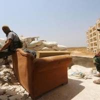 A look at Syria's extremist Nusra Front, known for holding captives for ransom