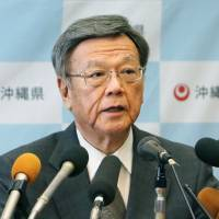 Okinawa Gov. Takeshi Onaga speaks at a news conference in Naha on Monday. | KYODO